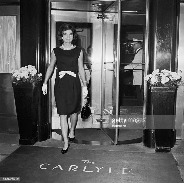 Mrs Jacqueline Kennedy wearing a becoming bowatthewaist number leaves the Hotel Carlyle here June 8th for the hospital to visit her fatherinlaw...