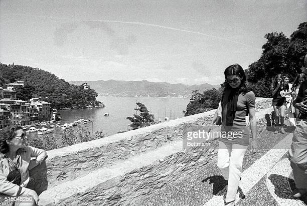 Mrs Jacqueline Onassis is accompanied by her daughter Caroline during sightseeing stroll in this Italian Riviera resort have June 14th Mrs Onassis...