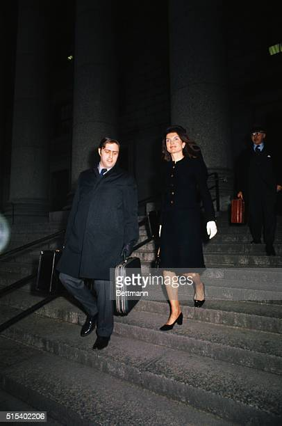 Mrs Jacqueline Onassis leaves Federal Building here after the second day of trial of countercharges involving freelance photographer Ronald E...