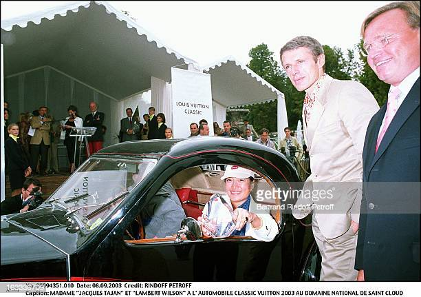 Mrs Jacques Tajan and Lambert Wilson at the Classic Automotive Vuitton 2003 at the national domain of Saint Cloud