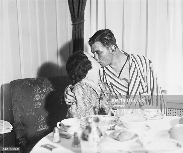 Mrs James Braddock gives the final congratulations in the form of a big kiss to husband Jimmy Braddock at their suite in the Mayflower hotel New York...