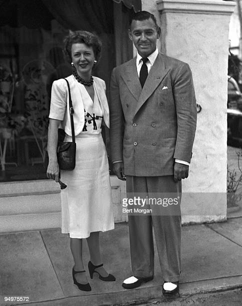 Mrs Jay J O'Brien Dorelis and actor Clark Gable standing in front of a store window Palm Beach Florida 1945