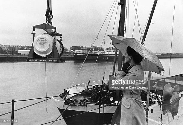 �Mrs Jean Thompson the lone protester watches a fuel flask being craned ashore from the Pool Fischer at BarrowinFurness Cumbria yesterday� Photograph...