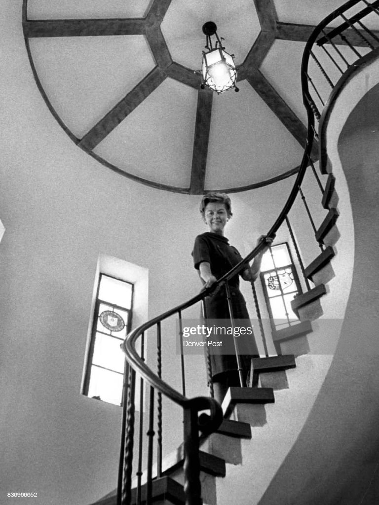 Mrs. John C. Davis III Stands On Spiral Staircase In Davis Home Which  Borders