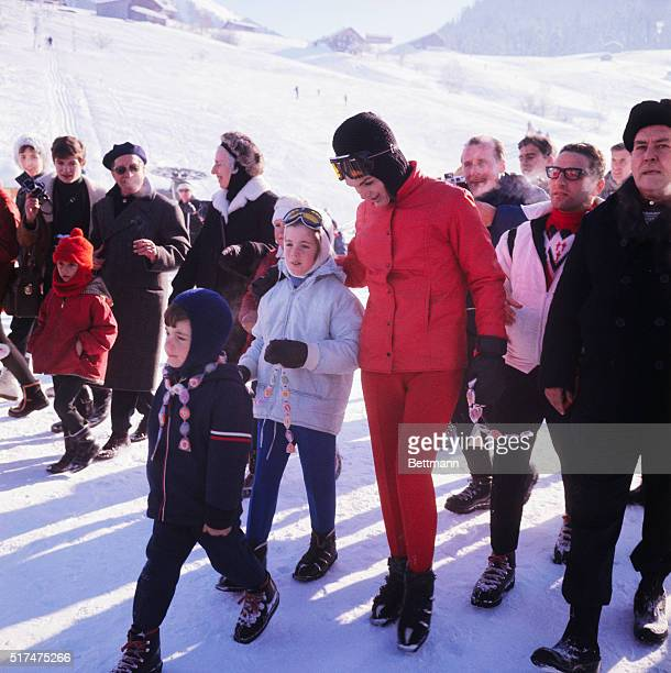 Mrs. John F. Kennedy and her two children, Caroline and John Jr. Are seen during a sledding party at the Windspillen Slope at this ski resort,...