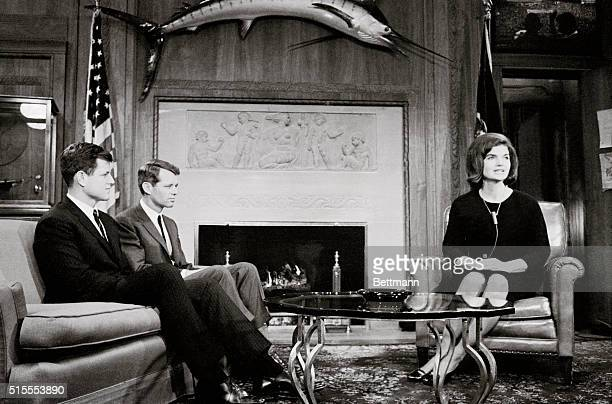 Mrs John F Kennedy waits with her brothersinlaw Senator Edward Kennedy DMass and Attorney General Robert F Kennedy in the latter's office in the...