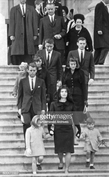 Mrs John F Kennedy walks down the Capitol steps with her daughter Caroline and son John Jr after the slain President's casket was placed in the...