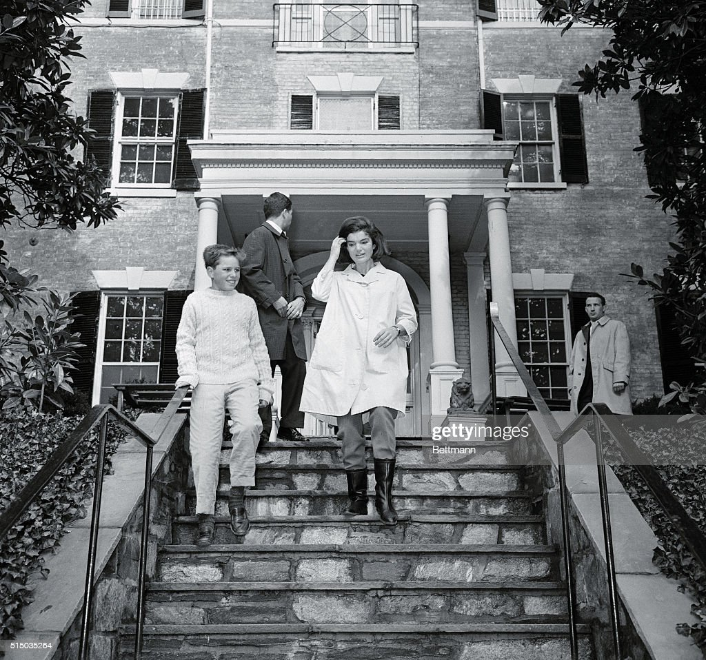 Mrs. John F. Kennedy Walks Down The Front Steps Of Her New