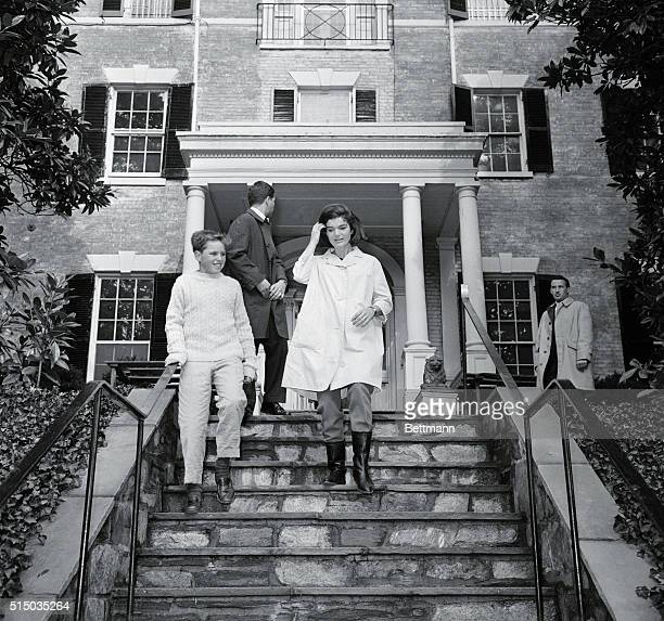 Mrs John F Kennedy walks down the front steps of her new home in the Georgetown section of the city today Mrs Kennedy and her children moved to the...