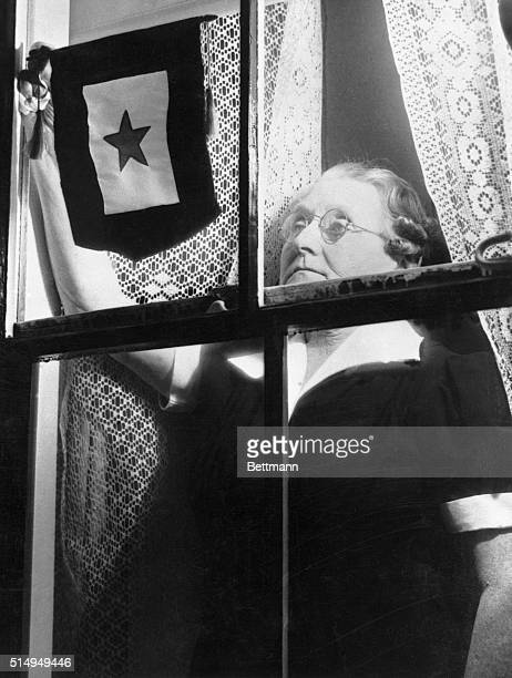 Mrs John Gagne of Lynn proudly places the gold star service flag in the window in her home following the news of the death of her son a member of the...
