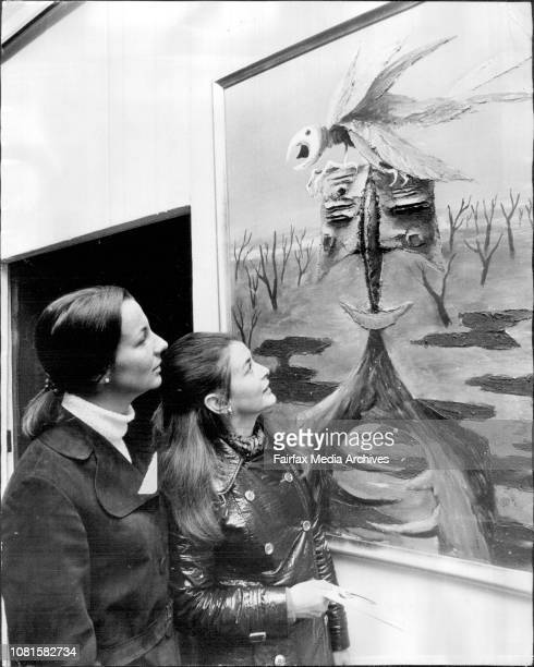 Mrs John Jennifer Wigan of French's Forest and Miss Alison MartinMiller of Paddington admire Mr Albert Tucker's 'Fawn attacked by Parrot' one of the...
