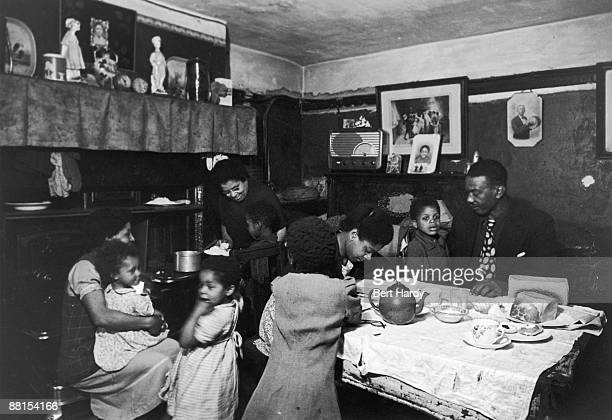 Mrs Johnson her two daughters a soninlaw and some of her grandchildren in their dining room UK 1949 Original Publication Picture Post 4825 Is There A...
