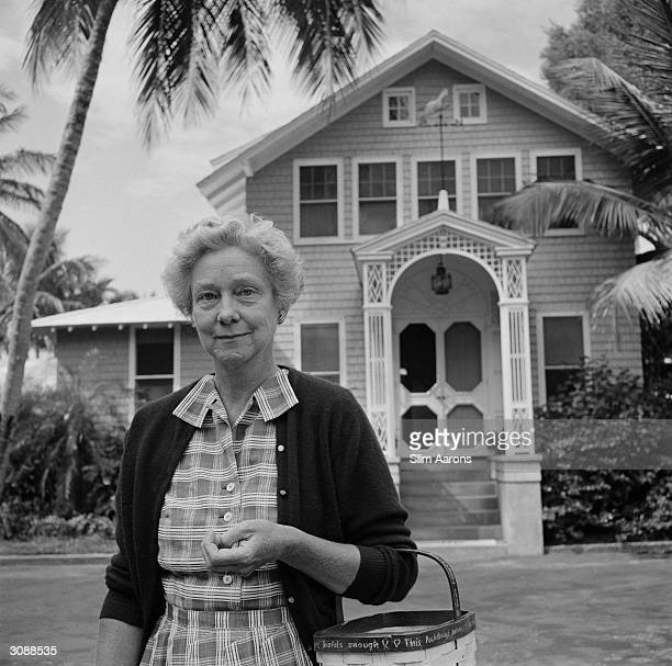 Mrs Joseph Verner Reed in front of the Jupiter Island Club Palm Beach circa 1960 A Wonderful Time Slim Aarons