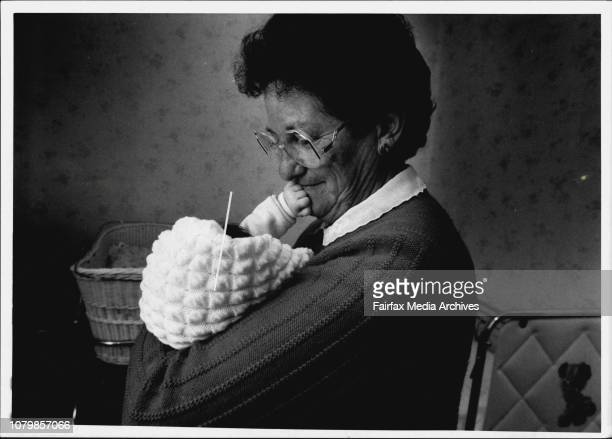 Mrs Judith Kerrigan pictured with the baby that she cares for as part of a home care scheme run by the State Govt for babies waiting for adoptionMrs...