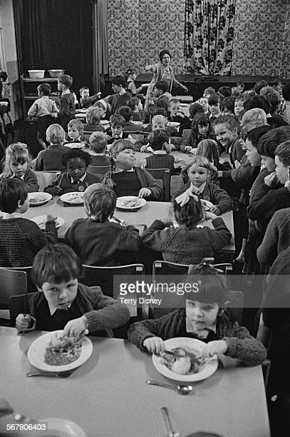 Mrs Kathryn Ashenden supervising lunchtime for pupils of St John's C Of E Primary School during a teacher strike Kilburn London 13th September 1967