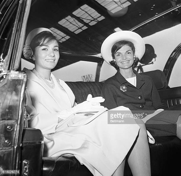 Mrs Kennedy and Empress Farah ride in a limousine from Washington National Airport today following welcoming ceremonies for Shah Far ah Far ah Far ah...