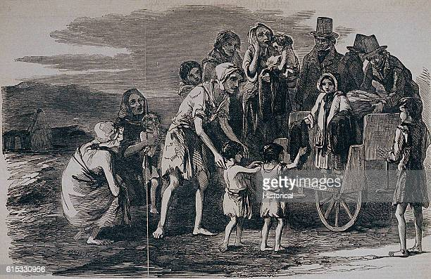 Mrs Kennedy gives clothing to victims of the Irish Famine at Kilrush Ireland 1849