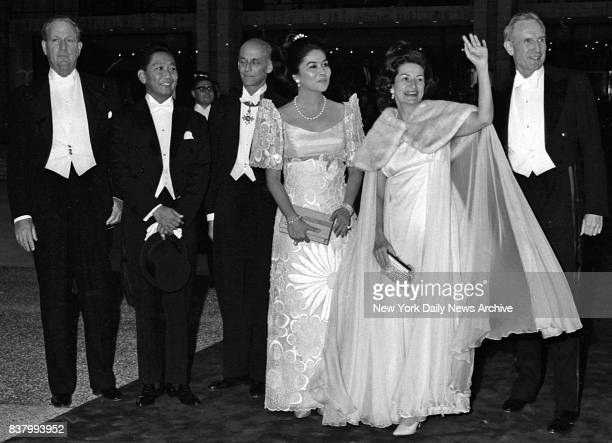 Mrs Lady Bird Johnson waves as she arrives escorted by President Marcos of Philippines Metropolitan Opera's Rudolf Bing Mrs Marcos and John D...
