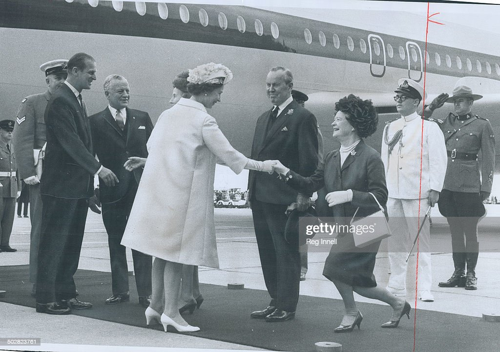 Mrs. Lester Pearson curtseys to Queen Elizabeth at Uplands Airport; Ottawa; and Canada's birthday ce : News Photo