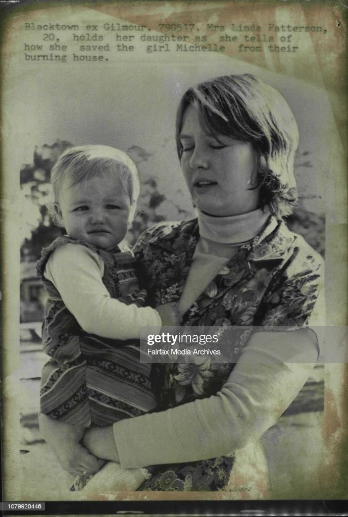 Mrs. Linda Patterson, 20, holds her daughter as she tells of how the saved the girl Michelle from their burning house.A young mother saved her baby daughter from a burning house at Blacktown today.Mrs. a Linda Patterson, 20, was alone at home with her one : ニュース写真