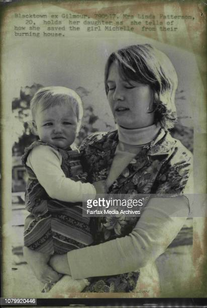 Mrs Linda Patterson holds her daughter as she tells of how the saved the girl Michelle from their burning houseA young mother saved her baby daughter...