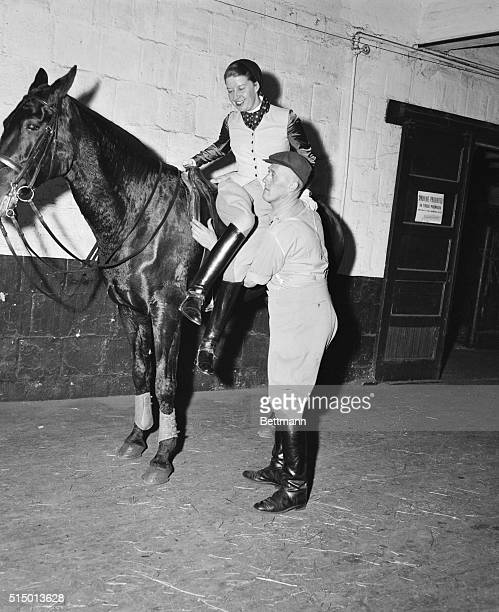 Mrs Lis Hartel Danish horsewoman who is the 1954 world's champion dressage champion in both the men's and women's classes is shown her during a...