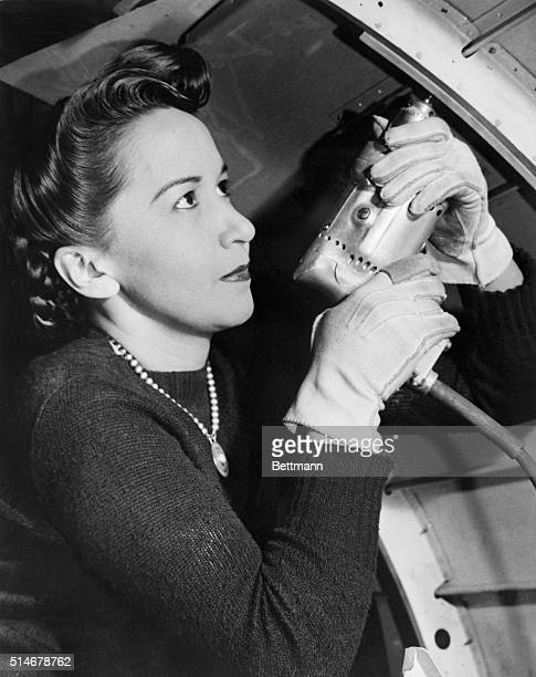 Mrs. Lola Boyle uses a riveter at her job at Brewster Aeronautical Corporation in Newark, New Jersey. Many women took production jobs to assist in...