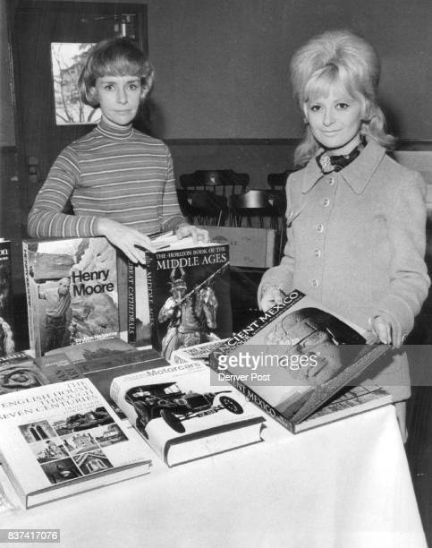 Mrs Lorraine Claussen left and Mrs James P Dikeou display books to be sold at Graland Country Day School's Book Fair Credit Denver Post