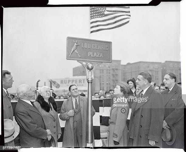 Mrs Lou Gehrig is shown unveiling the plaque to the memory of her husband at Gehrig Plaza today Left to right at the ceremony are Bill Dickey of the...