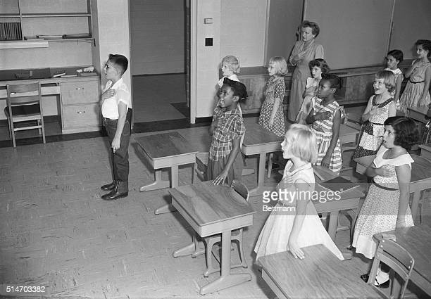 Mrs Louise Snee leads her Third Grade class in the Pledge of Allegiance at the Fort Myer Elementary School in September 1954 Although the public...