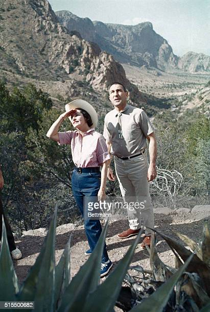 Mrs. Lyndon Johnson and Secretary of the Interior, Stewart Udall hike along the lost mine trail in the Chisos Mountains, here, April 2. They are...