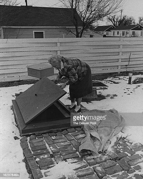 JAN 25 1963 221963 Mrs M W Marion prepares to enter her fallout shelter located in the backyard of her home at 1648 Oakland St Aurora