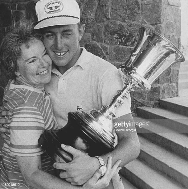 AUG 6 1966 AUG 8 1966 Mrs Mabel Irwin gives son victory hug Hale Irwin shows his mother trophy after winning state amateur golf championship