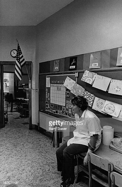 NOV 1972 NOV 8 1972 Mrs Madlen Barela takes breathes in classroom that was already remodeled