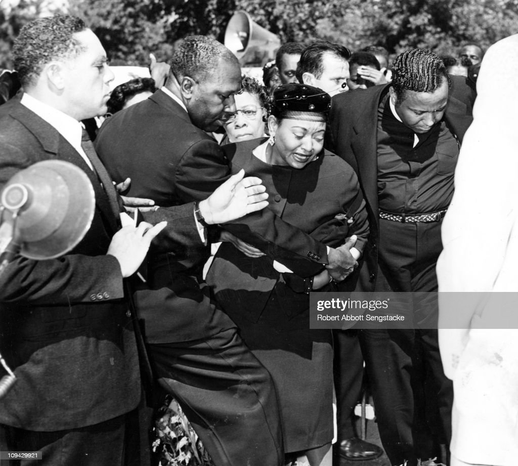 Mrs Mamie Bradley (center) reacts as the body of her son, Emmett Till, is lowered into his grave during the funeral, September 1955. Her son, fourteen year old Emmett Till, was shot and murdered in Greenwood, Mississippi.