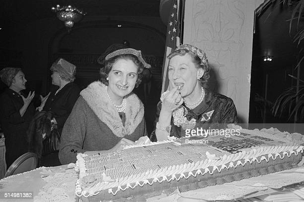 Mrs Mamie Eisenhower samples a piece of birthday cake at a joint birthday celebration given in her honor today by the Women's National Press Club The...