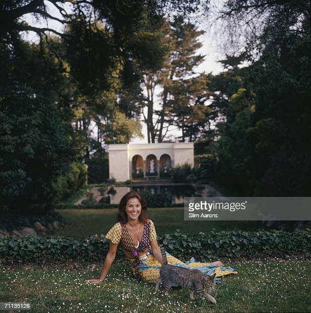 Mrs Manuel Rojas relaxes by the pond of Las Tejas her twentytwo acre estate in Santa Barbara California May 1975