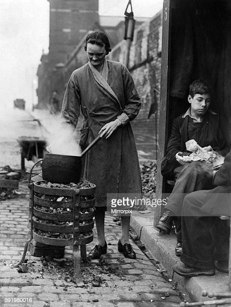 Mrs Margaret Jones whose home is in New Bridge St had been deprived of gas by the Manchester Gasworker's strike yesterday cooked a stew on the...