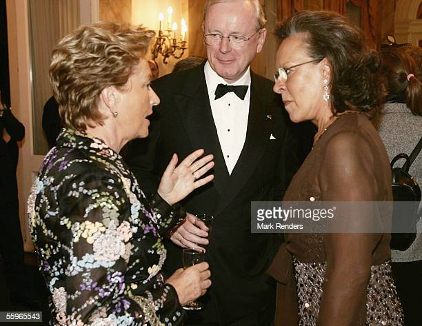 Mrs Maria Jose Ritta talks with Queen Paola of Belgium during a reception at the Cercle Gaulois in Brussels on October 19 2005 in the Belgian capital...
