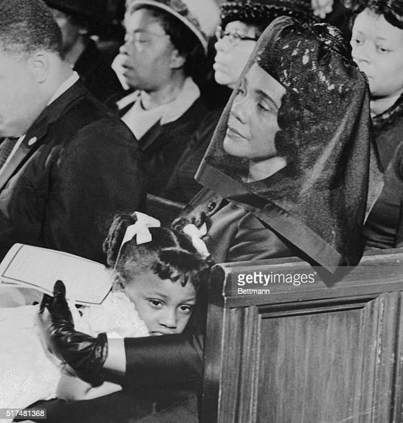 Mrs Martin Luther King Jr comforts her youngest daughter Bernice during services in the Ebenezer Baptist Church 4/9