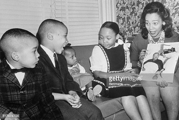 Mrs Martin Luther King Jr explains that Daddy's in the hospital to her children as she shows them a picture of the integration leader and his nurse...