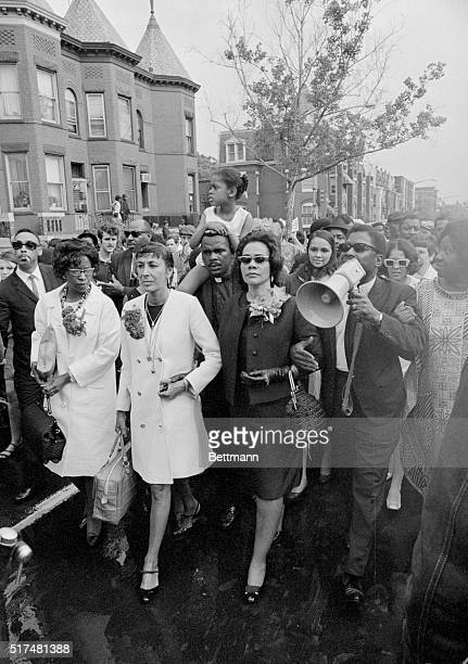 Mrs Martin Luther King shown walking hand in hand with Mrs Harry Belafonte leads a Mother's Day march for welfare rights here The parade kicked off...