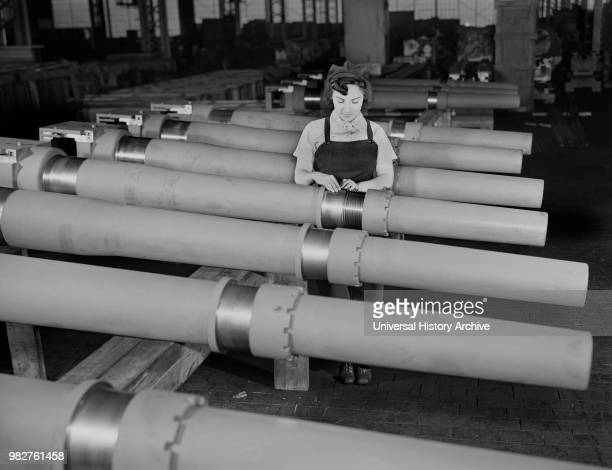 Mrs. Mary Betchner Inspecting 105mm Howitzer Artillery on Assembly Line, Chain Belt Company, Milwaukee, Wisconsin, USA, Howard R. Hollem for Office...