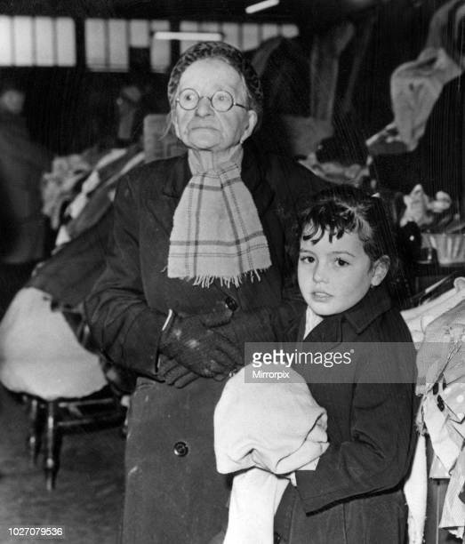 Mrs Mary Birchall, aged 86, with seven-year-old Anne Gaffrey, of Everton, at a market in Liverpool. 27th January 1964.