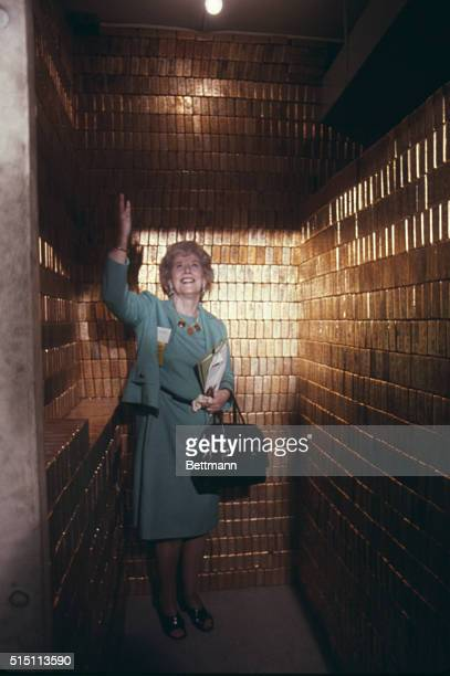 Mrs Mary Brooks Director of the Mint points her hand toward the ceiling to show off the gold bars stored in the United States Bullion Depository at...