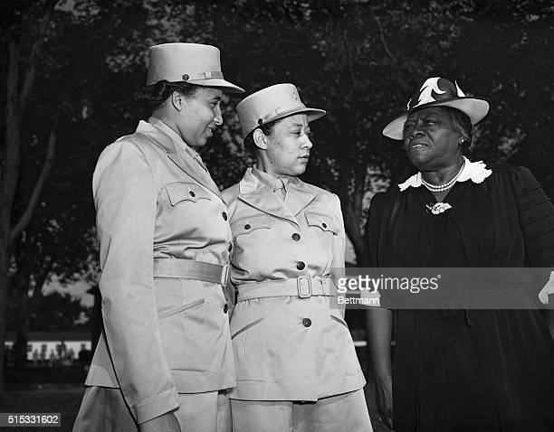 Mrs Mary McLeod Bethune is shown here chatting with Vera Harrison of Wilberforce Ohio and Mary Bordeaux of Louisville Kentucky soon after the members...