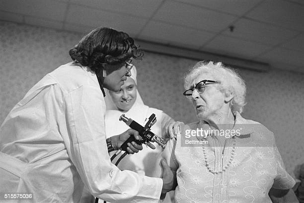 Mrs Mary O'Brien resident of the St Augustine Home Chicago winces 10/4 as she is inoculated against the swine flu Residents of the home for the aged...