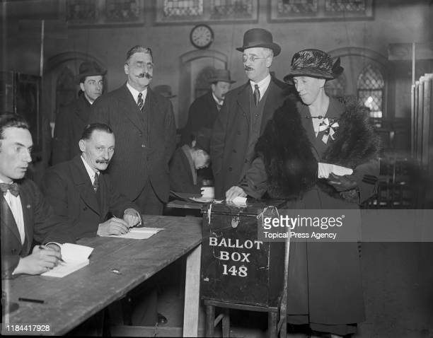 Mrs Mawbey is the first person to cast her vote at a polling station in Dulwich, south London, during the UK general election, 6th December 1923.