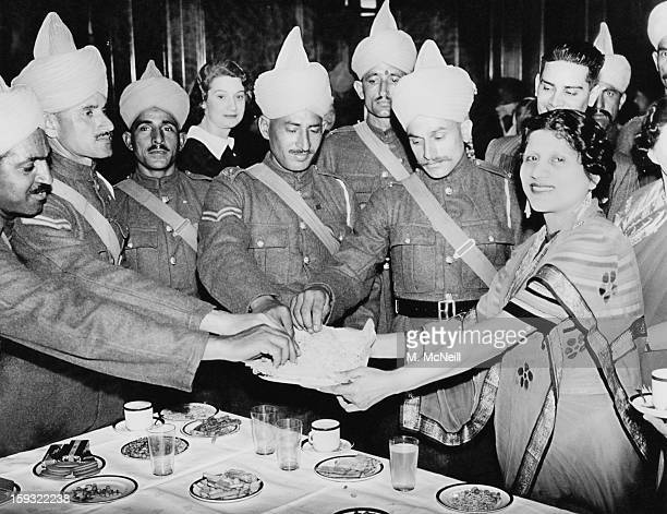 Mrs Mukerji , of the Indian Comforts Fund, serving refreshments to Indian troops, newly arrived from France, at India House, Aldwych, London, 9th May...