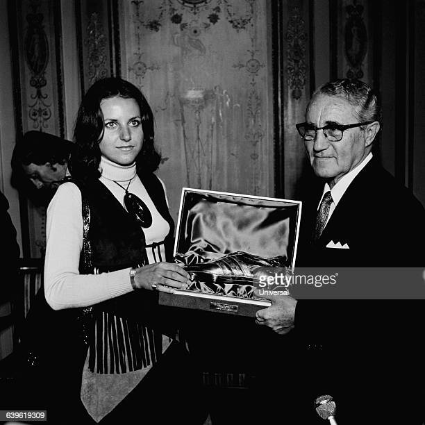 Mrs Muller receives the Soulier d'Or for her husband Gerd from Adolf Dassler known as Adi Dassler Dassler is the founder of the German sportswear...
